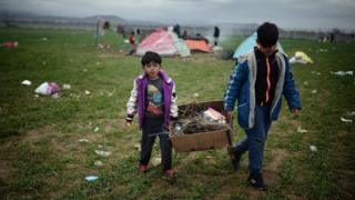 Children carrying fire wood at the Idomeni refugee camp.