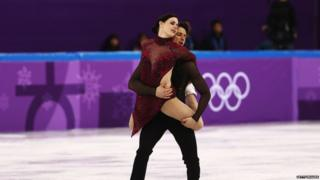 Tessa Virtue and Scott Moir perform during the ice dance segment of the team figure skating event