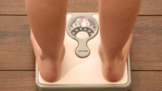 Child stood on scales