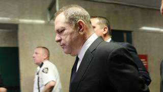 Harvey Weinstein is escorted in handcuffs into State Supreme Court after on Monday for arraignment on charges alleging he committed a sex crime against a third woman on July 9, 2018 in New York City.