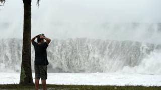 A boy looks at high waves generated by typhoon Hagibis in Atawa, Mie Prefecture, Japan, 12 October 2019.