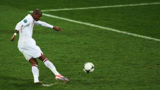Ashley Young takes a penalty.