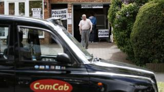 London Taxi outside polling station