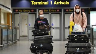 science Couple reaching arrivals at a UK airport