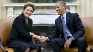 President Barack Obama shakes hands with Brazilian President Dilma Rousseff in the Oval Office of the White House - 30 June 2015