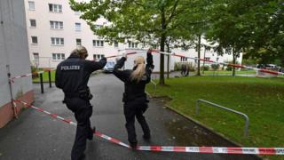 Police secure a residential area in Chemnitz, 9 October.