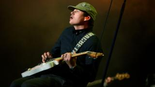 Tom DeLonge performing as part of Blink-182 at the Reading Festival in 2014