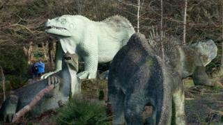 Dinosaurs in a park