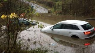 Car submerged in floodwaters