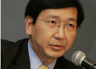 Professor Johannes M. Chan addresses the media during a press conference in Hong Kong in 2006