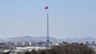 A North Korean flag flutters in the propaganda village of Gijeongdong