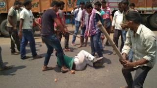 A group of men beating a man in West Bengal