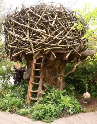 A treehouse in the Back to Nature Garden at Chelsea Flower Show