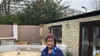 Linda Wardlaw in her garden
