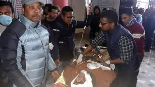 An injured Nepali passenger is transported to a hospital in Dang district, south-west of Kathmandu, on December 22, 2018