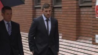 Adam Walker walking towards Leeds Crown Court