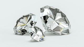 Diamonds of different sizes on white background