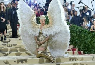 Katy Perry wears oversized angel wings in honour of this year's heavenly theme.