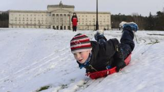 Boy playing in snow at Stormont