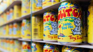 Cans of Cwtch beer