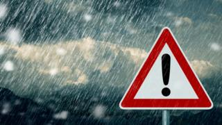 Rain with warning sign