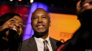 Ben Carson takes photos during the Urban League conference 31 July 2015