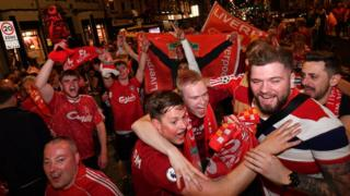 Liverpool fans celebrate their team's victory in the UEFA Champions League Final