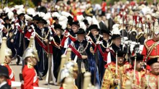 Knights of the garter parade through crowds in Windsor