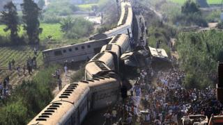 A general view of people by the wreckage after two passenger trains collided in Alexandria