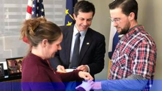 South Bend Mayor Pete Buttigieg (centre) marries Mary and Gabe