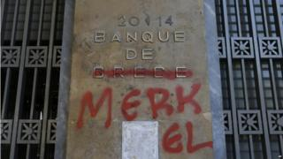 Bank of Greece plaque with Merkel graffiti