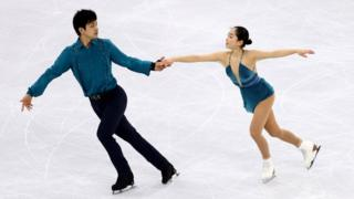 Miu Suzaki and Ryuichi Kihara figure skate at the Winter Olympics