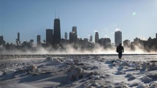 Man walks along frozen Chicago lakeside