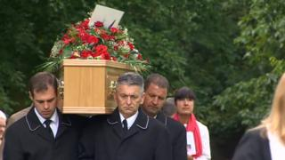 Spencer's coffin being carried at the church