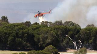 Helicopter putting out a wildfire