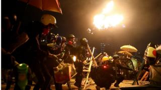 Anti-government protesters prepare molotov cocktails during clashes with police, outside Hong Kong Polytechnic University (PolyU) in Hong Kong, China, November 17, 2019.
