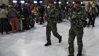 Soldiers patrol at Paris Charles de Gaulle airport as part of security measures set after the Paris attacks