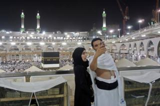 Muslim pilgrims take a selfie at the Grand Mosque in the holy Saudi city of Mecca, early on August 30, 2017, on the eve of the start of the annual Hajj pilgrimage. For the faithful it is a deeply spiritual journey, which for centuries every capable Muslim has been required to make at least once in their lifetimes. In the age of social media and live video streaming, it's now also an experience to be shared in real time.