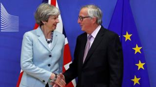 Theresa May and Jean-Claude Junker