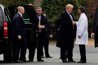 Donald Trump shakes hands with Dr Ronny Jackson after his annual physical exam at Walter Reed National Military Medical Center in Bethesda, Maryland, 12 January 2018