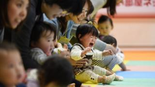 File image of mothers and children in Japan