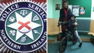 Adee with his mum Kirsty and his brand new bicycle at Dundonald Police station