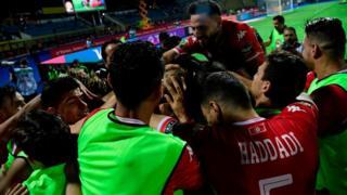 Les joueurs tunisiens célèbrent leur victoire.