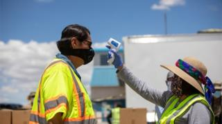 positive people Navajo Nation President Jonathan Nez has his temperature checked on May 27, 2020 in New Mexico, US