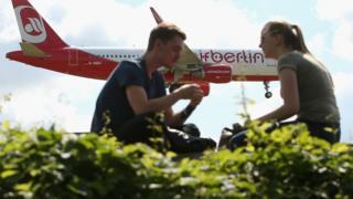 n Air Berlin airplane lands at Tegel Airport (TXL) on August 23, 2017