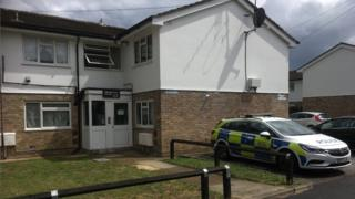 A block of flats with a police car outside on Canvey Island