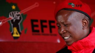 Julius Malema, leader of South Africa's s Economic Freedom Fighters (EFF) looks on before addressing his supporters in Etwatwa, a township near Benoni, South Africa - Wednesday 27 July 2016