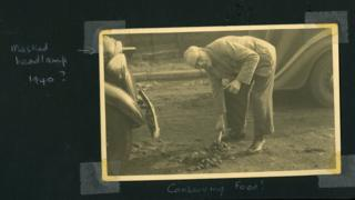 Betty Richard's father shovelling horse manure on a road