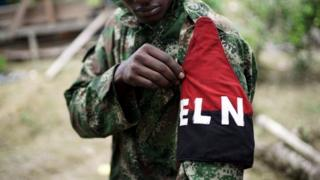 A rebel of Colombia's Marxist National Liberation Army (ELN) shows his armband while posing for a photograph, in the north-western jungles, Colombia August 31, 2017