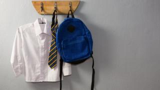 School uniform hanging on pegs